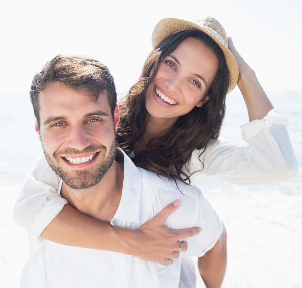 A young couple smiling near Dr. Cascante's Miami Dentists office