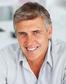 Image of a man smiling with Dental Crowns & Bridges from Miami Dentist Dr. Cascante