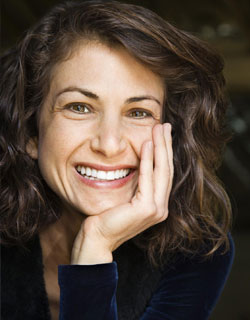 Image of a woman smiling with Dental Implants from Miami Dentist Dr. Cascante