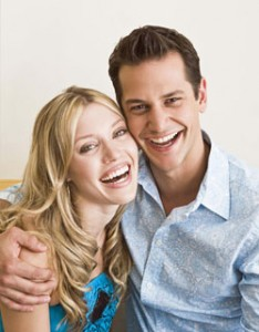 Image of a smiling couple benefiting from preventative dentistry in Miami