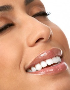 Image of woman smiling after undergoing Scaling & Root Planing at Dr. Cascante's Miami dental office.