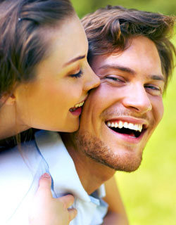 Image of a couple smiling with inlays & onlays from Miami Dentist Dr. Oscar Cascante
