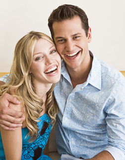 Image of a couple smiling after using Invisalign from Dr. Cascante's Miami office