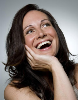 Image of a woman smiling after Botox treatments at Miami Cosmetic Dentist Dr. Cascantes' office.