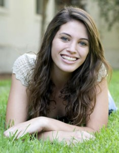 Image of young woman smiling with orthodontics from Miami Orthodontist Dr. Cascante