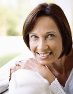 Image of a woman smiling with Porcelain Veneers from Cosmetic Dentist Dr. Cascante