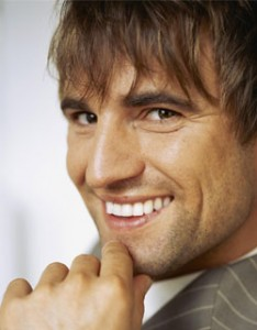 Image of a man smiling after undergoing teeth whitening treatment at Dr. Cascante's Miami dental office